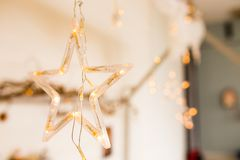 A glowing star with lights. a beautiful decoration for Christmas. New Year decor elements. Home stock photos