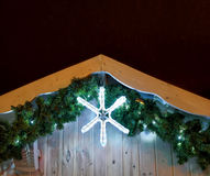Glowing star on top of stall at Vilnius Christmas Market. Glowing decoration in a shape of a star at the top of one of the stalls at the Christmas Market in royalty free stock photo