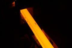 Glowing steel bar. Inside steel factory Stock Image