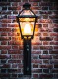 Glowing street light on brick wall. Stock Photo