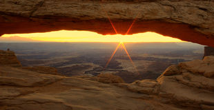 Glowing sunrise at Mesa Arch. Stock Photos
