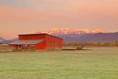 Glowing sunrise with a red barn Royalty Free Stock Photo