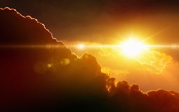 Glowing sunset, dark red clouds, bright sun rays Royalty Free Stock Image