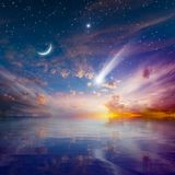 Glowing sunset with falling comet, rising crescent moon and star. Amazing peaceful background - beautiful glowing sunset with falling comet - mystical sign in stock photography