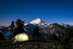 Glowing tent at night beneath Mount Baker, Washington state Stock Photos