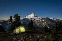 Glowing tent at night beneath Mount Baker, Washington state Stock Photography