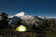 Glowing tent at night beneath Mount Baker, Washington state Royalty Free Stock Images