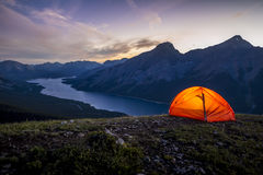 Glowing tent set up on a ridge for camping in the mountains Royalty Free Stock Photo