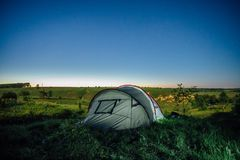 Glowing tent at summer night royalty free stock photos