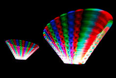 Glowing trail rotating LED, in form of cones Royalty Free Stock Photos