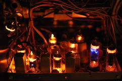 Glowing tubes in antique radio. The inside of a vintage radio is illuminated by glowing vacuum tubes Stock Photo