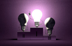 Glowing tungsten light bulb character and dead ones on podium. Glowing tungsten light bulb character in moment of insight and two switched off ones on podium on Royalty Free Stock Photography