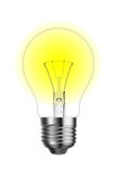 Glowing tungsten lightbulb. On white background Royalty Free Stock Images