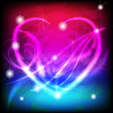 Glowing Valentine heart in magic background Stock Images
