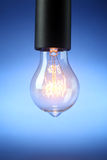 Glowing vintage light bulb Stock Photos