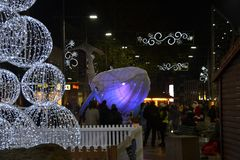Glowing whale, Big Blue, in the city centre of Reading in England, UK in December 2018,. Reading, Berkshire/England UK - December 14 2018: Magical Christmas in stock image