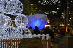 Glowing whale, Big Blue, in the city centre of Reading in England, UK in December 2018,. Reading, Berkshire/England UK - December 14 2018: Magical Christmas in royalty free stock photography
