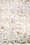Glowing White Light Fence. White fence decorated with holiday lights Stock Photo