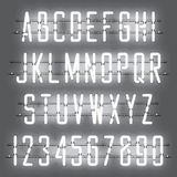 Glowing White Neon Casual Script Font. With uppercase letters from A to Z and digits from 0 to 9 with wires, tubes, brackets and holders. Shining and glowing Stock Photos