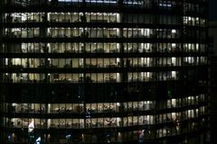 Glowing windows of skyscrapers at evening - View of modern offices in a building royalty free stock photo