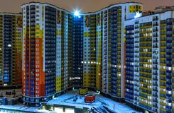 Glowing windows of skyscrapers at night. View of modern residential high-rise buildings in residential area of the metropolis . royalty free stock photo