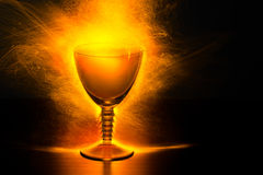 Glowing Wine Glass with Sparks Stock Photos