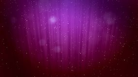 Glowing winter purple background with snowfall and rays like the northern lights. Use it as a winter background with. Bokeh and copy space for a Christmas or stock video