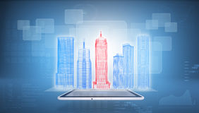 Glowing wire-frame buildings on screen tablet pc Stock Photography