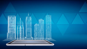 Glowing wire-frame buildings on screen tablet pc Royalty Free Stock Image