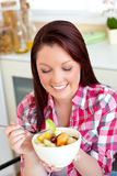 Glowing woman eating a healthy salad Royalty Free Stock Images