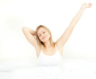 Glowing woman stretching while getting up Royalty Free Stock Photo