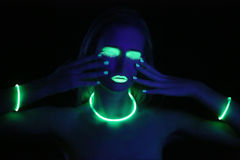 Glowing Woman Wearing UV Cosmetics Under Black Light Royalty Free Stock Photo