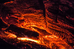 Glowing wood furnace. Large piece of glowing hot coals with detailed texture Stock Images