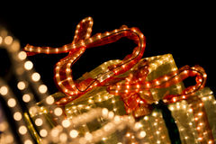 Glowing xmas presents. Colorful red orange golden lights illumating christmas presents Royalty Free Stock Photo