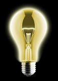 Glowing yellow light bulb Royalty Free Stock Photo