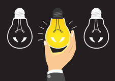 Glowing yellow light bulb after being turned on Royalty Free Stock Photography