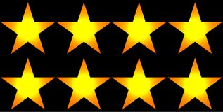 Glowing yellow stars against a black background Royalty Free Stock Photography