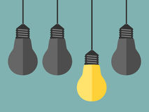 Glowing yellow unique lightbulb Royalty Free Stock Image