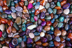 Gluck stones. Happiness stones. Full frame colorful polished gemstones background. Close-up Stock Images