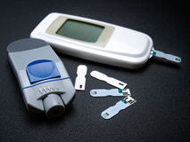 Glucometer. Or diabetic testing kit on a dark background Royalty Free Stock Photo