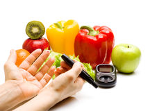 Glucometer. fresh fruits, concept for diabetes, slimming, healthy nutrition and strengthening immunity Stock Photography