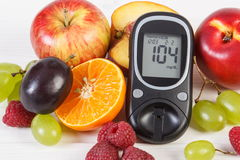 Glucometer and fresh fruits, diabetes and healthy nutrition Royalty Free Stock Image