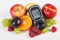 Glucometer and fresh fruits, diabetes and healthy nutrition Royalty Free Stock Images
