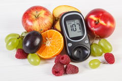 Glucometer and fresh fruits, diabetes and healthy nutrition Royalty Free Stock Photo