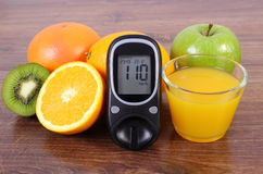 Glucometer, fresh fruits and juice, diabetes, healthy lifestyles and nutrition Stock Photos