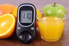 Glucometer, fresh fruits and juice, diabetes, healthy lifestyles and nutrition Royalty Free Stock Image