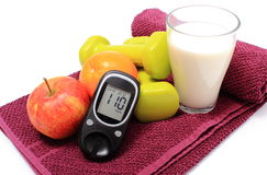 Glucometer, fresh fruits, milk and accessories for fitness Stock Photo