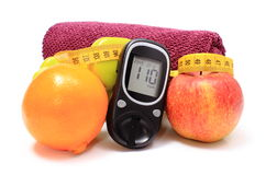 Glucometer, fresh fruits, tape measure, accessories for fitness Royalty Free Stock Image