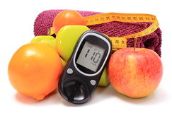 Glucometer, fresh fruits, tape measure, accessories for fitness Royalty Free Stock Photos