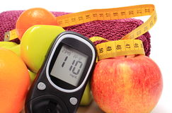 Glucometer, fresh fruits, tape measure, accessories for fitness Stock Photography
